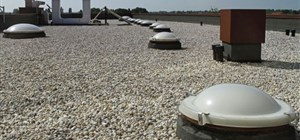Summertime Maintenance for Your Flat Roof